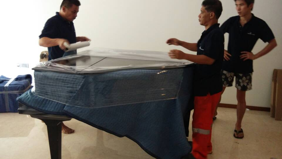 Residential Moving - wrapping piano 3